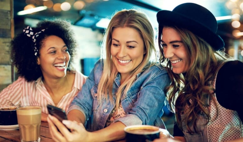 image of women using phone