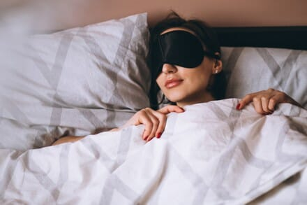 image of woman asleep in bed
