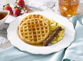 Homestyle Waffles with Scrambled Eggs and Maple Syrup